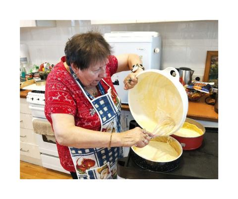 Belvedere resident baking German cake
